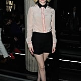 January Jones took on a boyish-cum-mod look in a colorblocked blouse at Miu Miu.