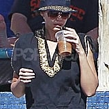 Jessica Alba sipped iced coffee.