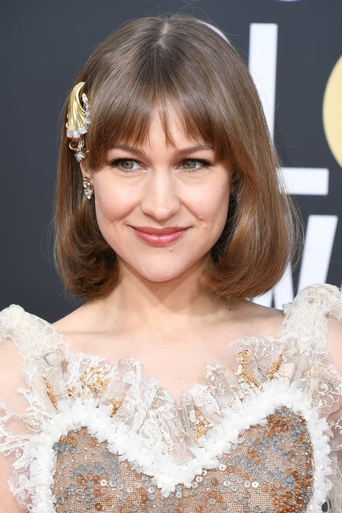 When musician Joanna Newsom stepped on the Golden Globes red carpet, we couldn't look away from her silky bob and bangs, but it wasn't until she turned her head that we were truly floored. The multi-talented artist attended the awards to support husband and show host Andy Samberg, while wearing a '20s inspired art deco barrette in her hair, placed right above her ear which matched a bangle on her wrist. She kept her makeup simple with an apricot lip and cheek. See the classic look, ahead.       Related:                                                                                                           Why Kendall Jenner's Acne Going Viral Is Part of a Bigger Problem