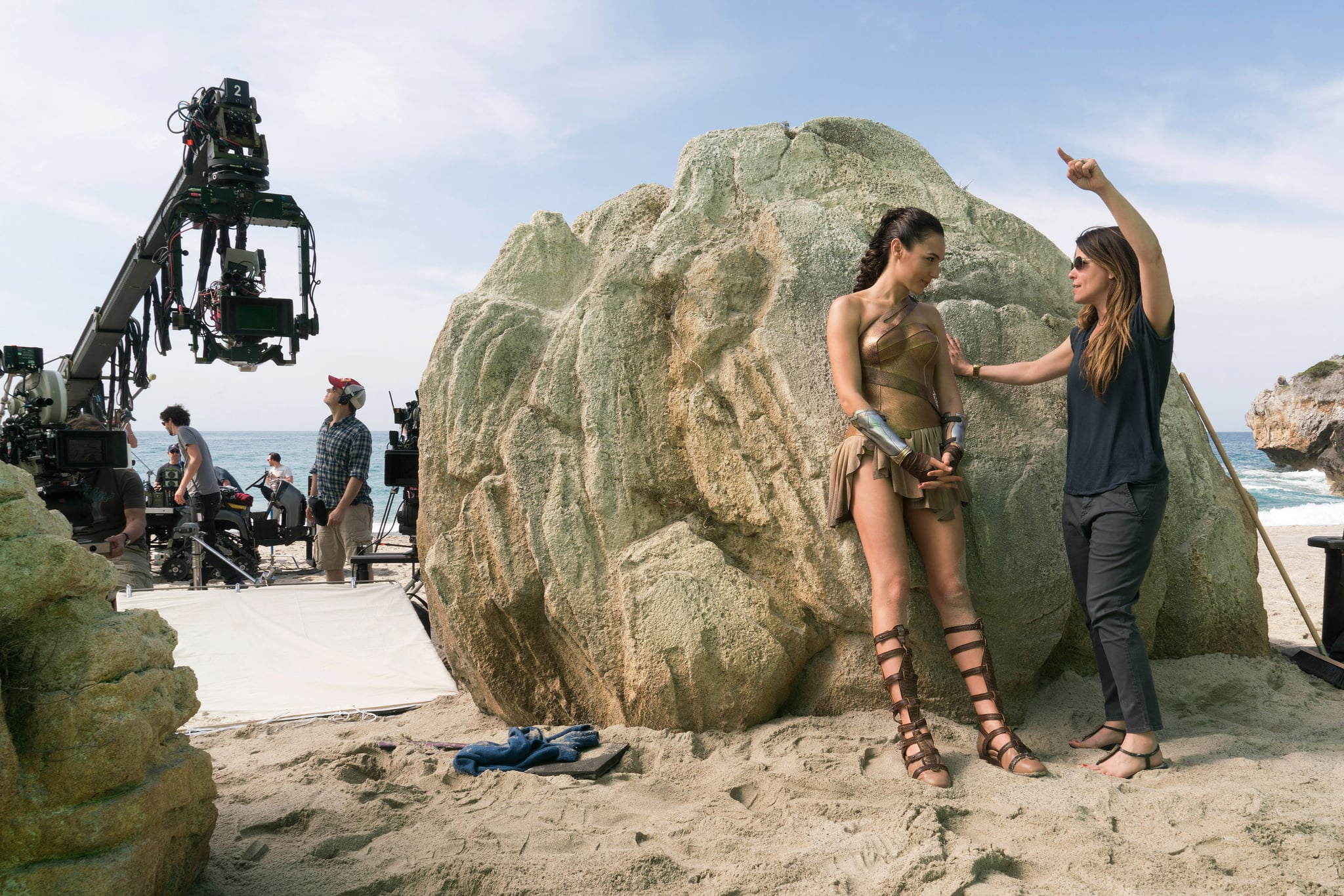 WONDER WOMAN, l-r: Gal Gadot, director Patty Jenkins on set, 2017. ph: Clay Enos/Warner Bros./courtesy Everett Collection