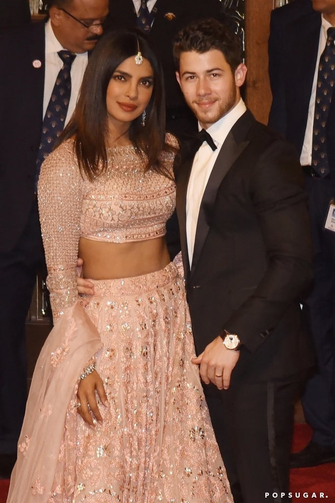 "Nick Jonas and Priyanka Chopra might be new to marriage, but they've already got the look of love down pat. On Dec. 12, almost two weeks after their own wedding, they attended the marriage of Isha Ambani — the 27-year-old daughter of India's wealthiest man — and 33-year-old executive director Anand Piramal. During the festivities, Nick and Priyanka posed for a few photos, looking as happy as ever. Priyanka stunned in an embellished peach lehenga by Jade, and Nick, who held his wife around the waist, was dapper in a tuxedo.  The 36-year-old actress and 26-year-old singer have been making the rounds since their three-day wedding jamboree in India. On Dec. 5, a few days after tying the knot, they made their official red carpet debut as husband and wife at Bumble's launch party in New Delhi. They were also all smiles when they touched down in Udaipur, India, to attend Isha's prewedding celebration that featured an amazing performance by Beyoncé.  Priyanka and Nick have also been very open with their love for each other on social media. A week after their big day, Nick shared a sweet photo of them cutting their wedding cake, captioning it, ""One week ago today."" He also shared a funny video of them watching Will Ferrell's beloved film Elf together. Priyanka even changed her name on Instagram to reflect her new full title: Priyanka Chopra Jonas. She also posted a cute selfie of her cuddled up with Nick, saying that they're in ""marital bliss."" Well, they definitely appeared to be in marital bliss at Isha's wedding, and we have to admit, they're one good-looking couple. Keep reading to see even more pictures of them at the event ahead.      Related:                                                                                                           Priyanka Chopra May Look Taller Than Nick Jonas, but Turns Out, It's Just an Illusion"