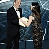 Sandra Bullock presented an award to William Goldenberg at the 2013 Oscars.