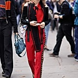 Wear a Black Scarf With Red Track-Inspired Pants