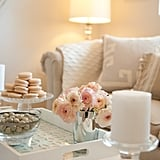 Cozy accents make the sofa inviting for guests and Jason, who loves to curl up on it with Lauren.