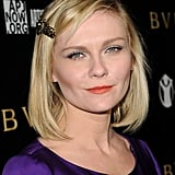 Kirsten Dunst opted for the schoolgirl classic, holding the wider side of a side parting back with a long jewelled clip. This is a useful style if you always end up tucking your hair behind your ear.