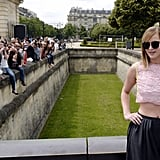 Jennifer Lawrence posed in a crop top before heading into the Christian Dior show on Monday.