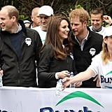 Prince Harry leaned in to chat with Kate while they were handing out water to runners during the 2017 London Marathon.
