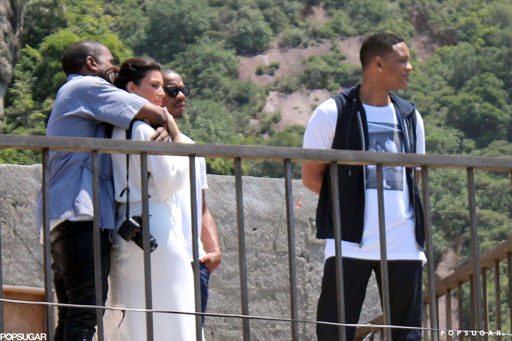 "Kim Kardashian and Kanye West showed PDA as they took in the sights of Vidigal, Brazil on Sunday. The couple hung out with Will Smith during their latest tourist excursion for Brazil's Carnival celebration. They were also spotted snapping photos of Will Smith as he danced on a hotel balcony which was located directly over their hotel room. It was a big day for Kanye, who skipped out on the Grammys for the romantic getaway with Kim. Although he was absent from last night's festivities, Kanye took home three awards for best rap song, best rap performance, and best rap collaboration with Jay-Z and Frank Ocean. Jay-Z, however, was in attendance to celebrate the honor by sipping Champagne with Jessica Biel in his seat. He also hopped on stage to accompany Justin Timberlake for his live performance of their track, ""Suit & Tie."" Check out all of the highlights from the Grammys last night! Kim Kardashian and Kanye West's vacation in Brazil comes ahead of a special occasion for the pair — Thursday will mark the expectant couple's first Valentine's Day together, and they already got a head start on the celebrations. Last week, Kim and Kanye packed on the PDA during their stay in Rio, and they shared a sweet moment when they visited Brazil's iconic Christ the Redeemer statue together on Friday."