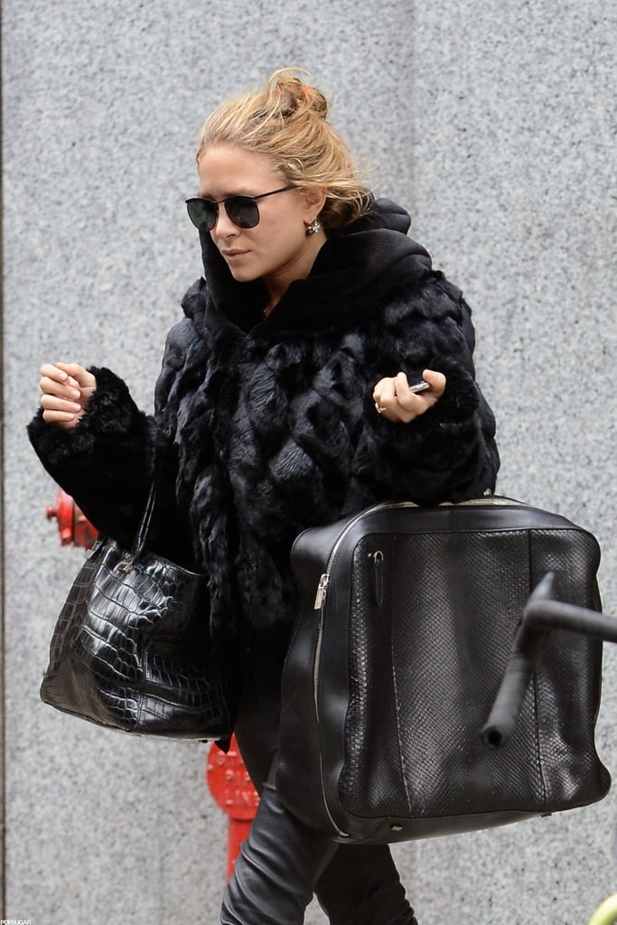 Mary-Kate Olsen had her hands full in NYC.