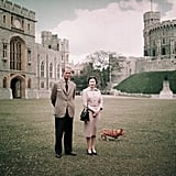 Queen Elizabeth, Prince Philip, and one of their corgis at Windsor Castle in 1959