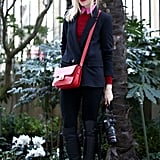 Sweet pops of red and pink gave a girlie side to her boyish separates.
