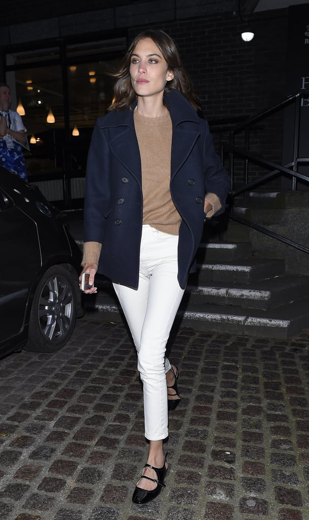 Alexa Chung channeled the J.Crew look with a navy blazer, white pants, and beige sweater.