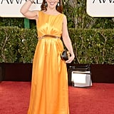 Alyssa Milano waved to fans as she posed for pictures on the red carpet.