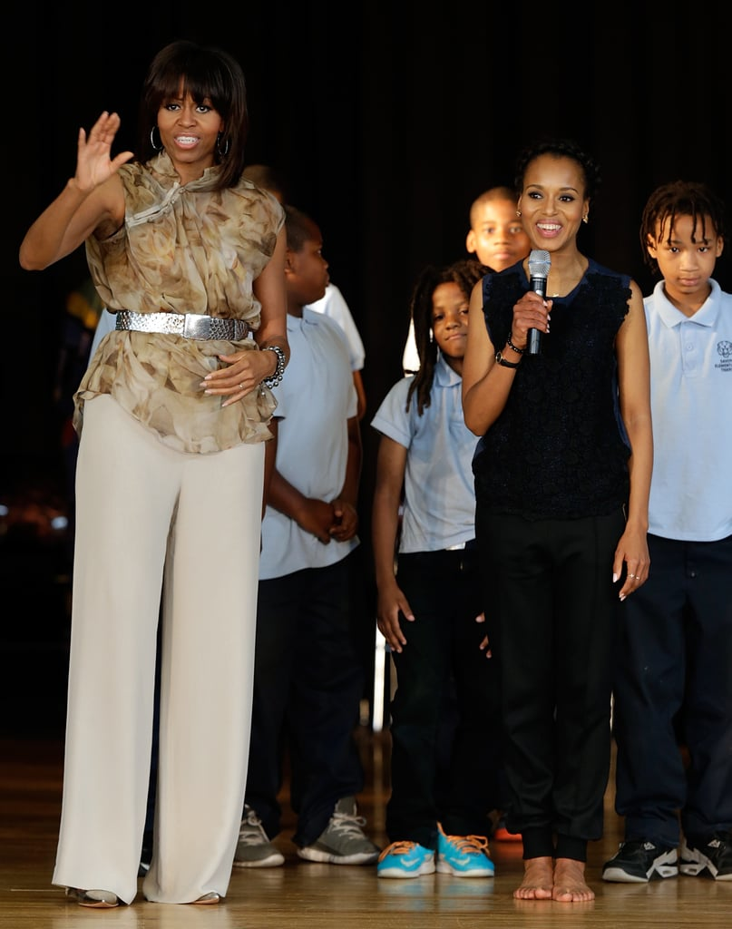 The FLOTUS looked equal parts sophisticated and cool in a flowy blouse, wide-leg trousers, and a metallic belt while speaking at an event at the Savoy School in May.