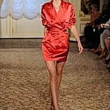 We gravitate toward mystery. Is it a dress? Is it a coat? It's a sexy red dress coat. Fabulous!