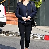 Witherspoon melded navy and black with a quilted leather-detail Club Monaco jacket, black denim, and classic pumps in LA.