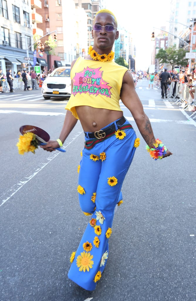 A guest wearing a cropped tee and sunflower appliqué pants with a Gucci belt.