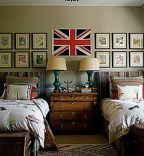 Lindsey and Kristen Buckingham decorated their son Will's bedroom with custom bedding, a vintage Union Jack flag, and neat rows of framed artwork.  Source
