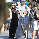 Victoria Beckham and David Beckham held Harper Beckham and strolled around Disneyland.