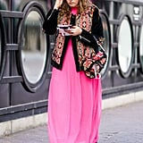 Style an embroidered jacket over a bright pink maxi dress.