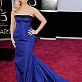 Mom of three Reese Witherspoon wore Louis Vuitton on the red carpet at tonight's Oscars.