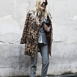 This Paris showgoer edged up her normcore look with leopard print. Brilliant.