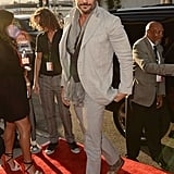 Joe Manganiello looked handsome as always in a suit and scarf.