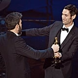 Ben Affleck and Malik Bendjelloul on stage at the Oscars 2013.