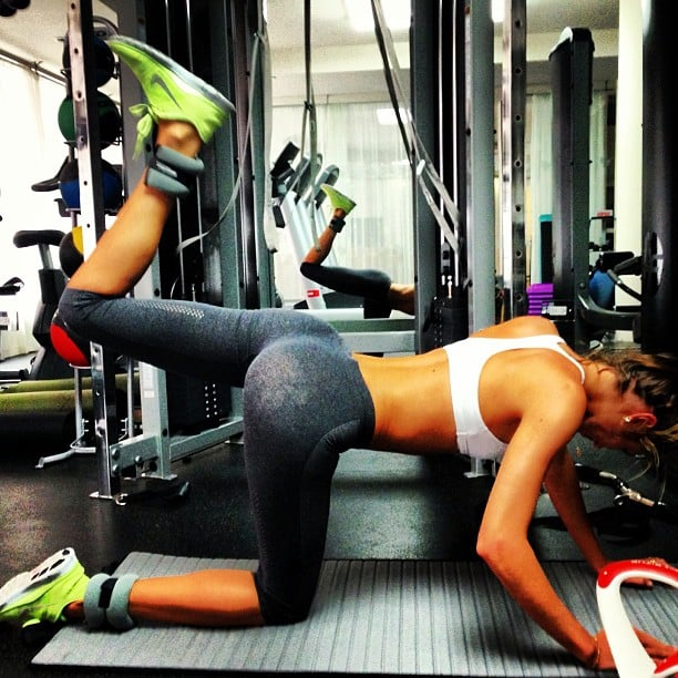Candice Swanepoel shared a photo while working out in some serious neon sneaks. Source: Instagram user angelcandices
