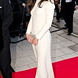 The gown fits Kate's figure perfectly and balances the leg-baring slit with long sleeves.