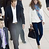 The Duchess carried a Longchamp Le Pliage bag.
