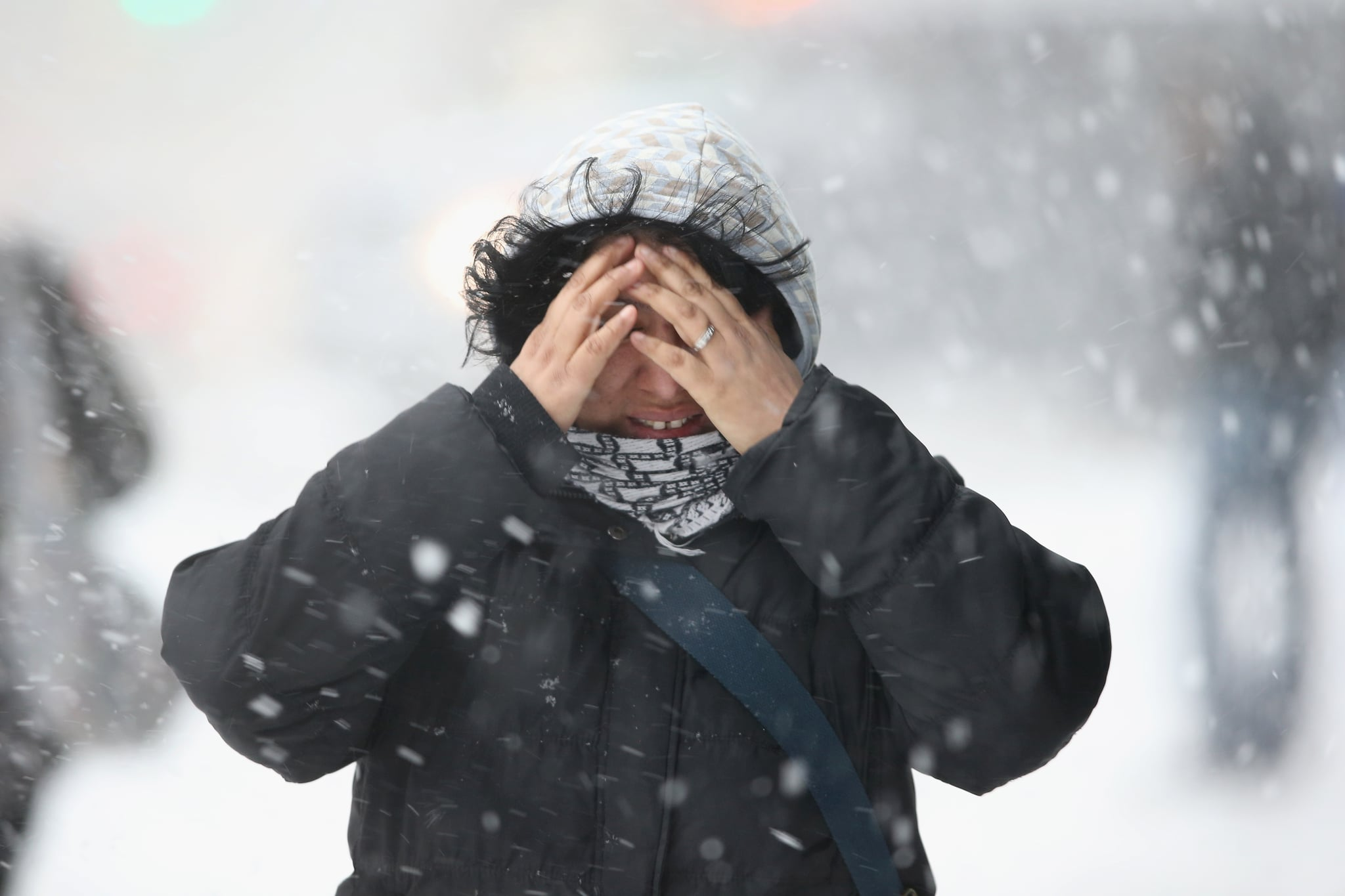 One woman covered her face as she walked through the snow in NYC.