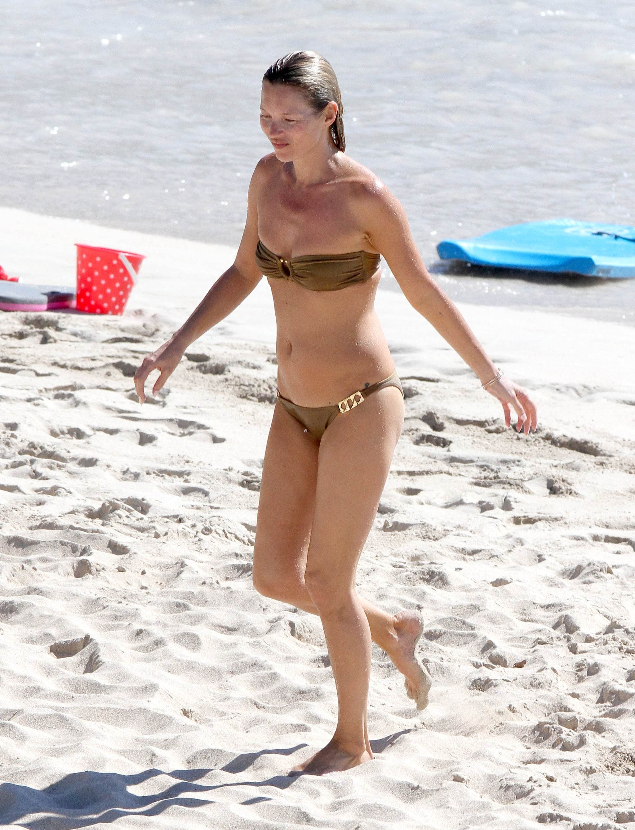 Kate Moss made her way up the sand.