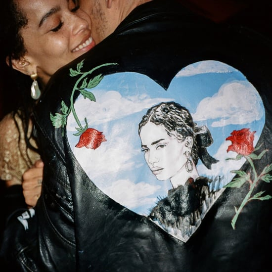 Karl Glusman Wears Leather Jacket With Zoë Kravtiz's Face
