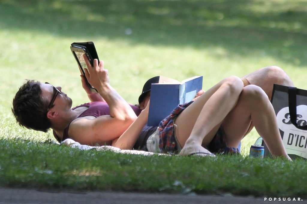 Jennifer Lawrence and Nicholas Hoult read their books at a park in Montreal.