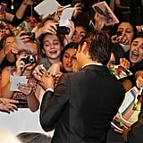 Zac Efron signed autographs for his fans at The Lucky One premiere in Melbourne.