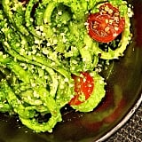Zucchini noodles with almond pesto and tomatoes.