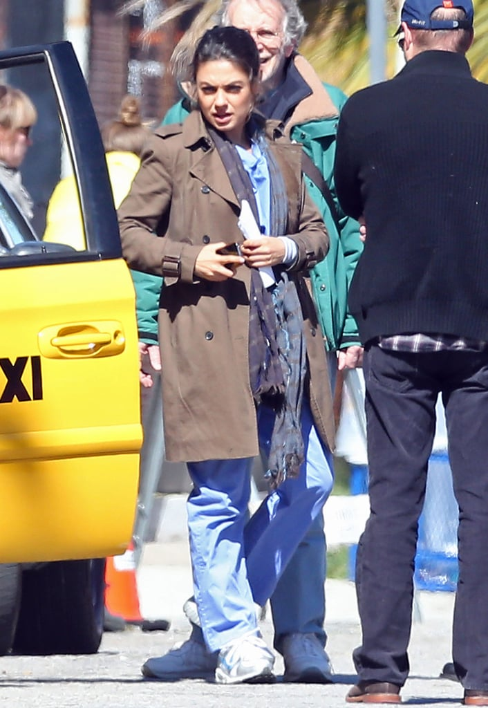 Mila Kunis rocked scrubs during filming for The Angriest Man in Brooklyn on Wednesday.