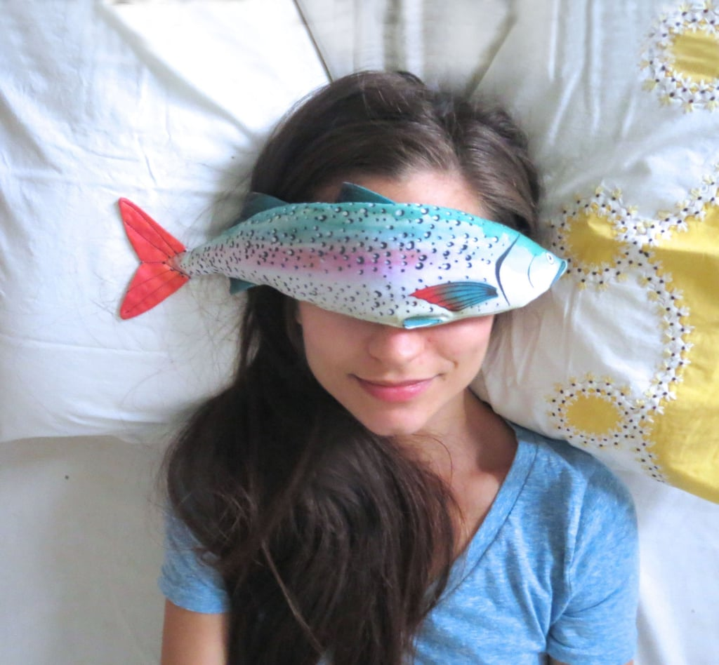 "After a long and stressful day, there are few things more relaxing than putting a fish on your face. At least that's what Alia Grace thought when she began making soothing lavender-filled fish eye pillows in 2014. The textile enthusiast currently sells the quirky eye pillows on Etsy for $36 each. The pillows — which come in various colorful prints — are made with organic cotton and filled with lavender and flax seed. In the product description, Alia wrote, ""I love the whimsical nature of these fish as well as their functionality and therapeutic, relaxing powers."" She also clarified that the pillows can be warmed or cooled as desired. The pillows have received high praise from buyers, as they have all received an average review of five stars, Etsy's highest. Under the Tropical Rainbow Fish listing, one review read, ""I bought this for my best friend and she said it's been the best sleep of her life."" Another read, ""Smells like heaven! Helps me fall asleep soundly at night or when I have a headache."" Look ahead for pictures of these funny-looking, all-natural sleep enhancers.      Related:                                                                                                           This ASMR Expert Talks Tips For Sleeping Better"