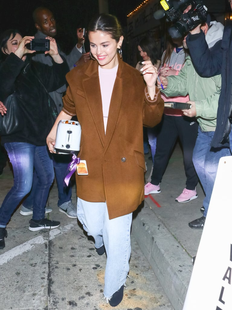Selena Wearing a Light Pink Turtleneck With Mom Jeans
