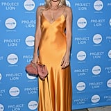 A simple sheath dress in a standout colour made Sienna shine at a UNICEF event.