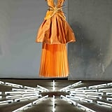 Cantaloupe Pleated Silk, Draped Silk Georgette, and Taffeta Gown with Gold Ray Belt