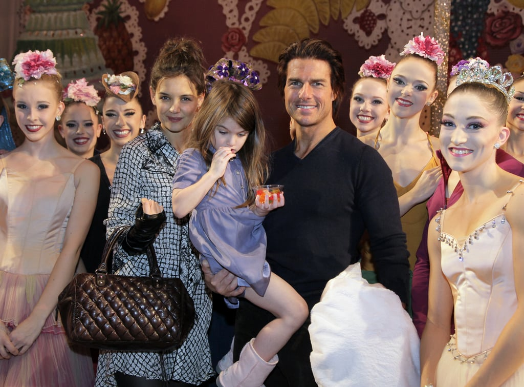 Tom Cruise, Katie Holmes, and Suri Cruise posed with the ballerinas backstage after attending a performance of The Nutcracker in NYC last night. The 4-year-old looked a little more into her candy than the photo op, though she gave a shy smile when one of the sugar plum fairies showed off her wand. Katie and Tom also chatted with the show's master in chief, Peter Martins. Katie may be making a return to the stage herself, since she's in talks to star in Extremities on Broadway. The Cruises just went from one chilly climate to another, traveling from Vancouver where he was shooting Mission: Impossible 4 to the East Coast for Katie's birthday weekend. She turns 32 today, one month after celebrating her fourth wedding anniversary with Tom. He loves to go all out for his girls, so there's probably more fun up his sleeve for this evening.   Photo Credit: © Paul Kolnik and INFDaily.com