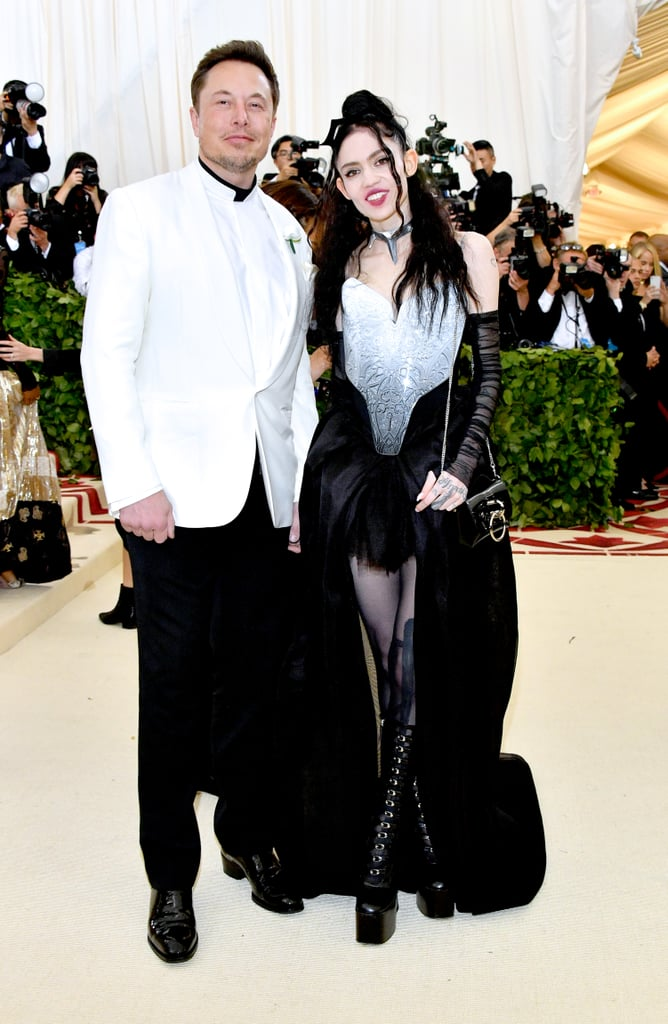 The Met Gala red carpet always brings us plenty of celebrity couples action, and this year was no exception. Not only did Riverdale couple Lili Reinhart and Cole Sprouse chose the big night to make their first official outing as a couple, so did Elon Musk and Grimes. The tech magnate and the musician (whose real name is Claire Boucher) have apparently been dating for a short while, and they shared a few emoji-laden tweets hinting at that, but this is the first time they've stepped out together on the red carpet. Their big moment could have turned awkward, as Elon's ex, Amber Heard, who he split from in 2017, was also in attendance. However, it looks like they managed to avoid each other on the red carpet, and Elon and Grimes looked totally loved-up as they posed and giggled their way down the red carpet. Take a closer look ahead!