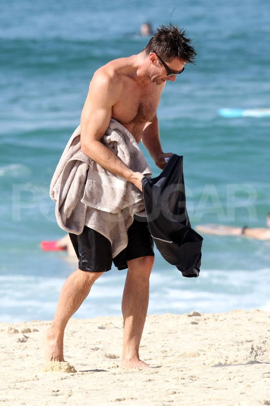Hugh Jackman got dressed after a shirtless swim in the ocean.