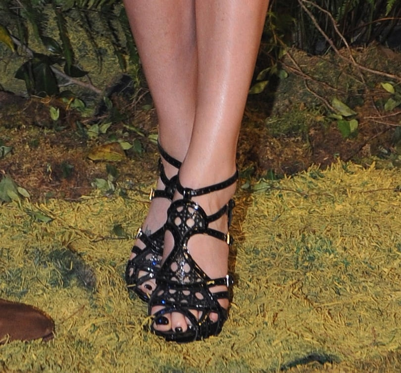 Charlize paired her edgy leather look with gladiator-inspired Christian Dior sandals for the Tokyo press conference.