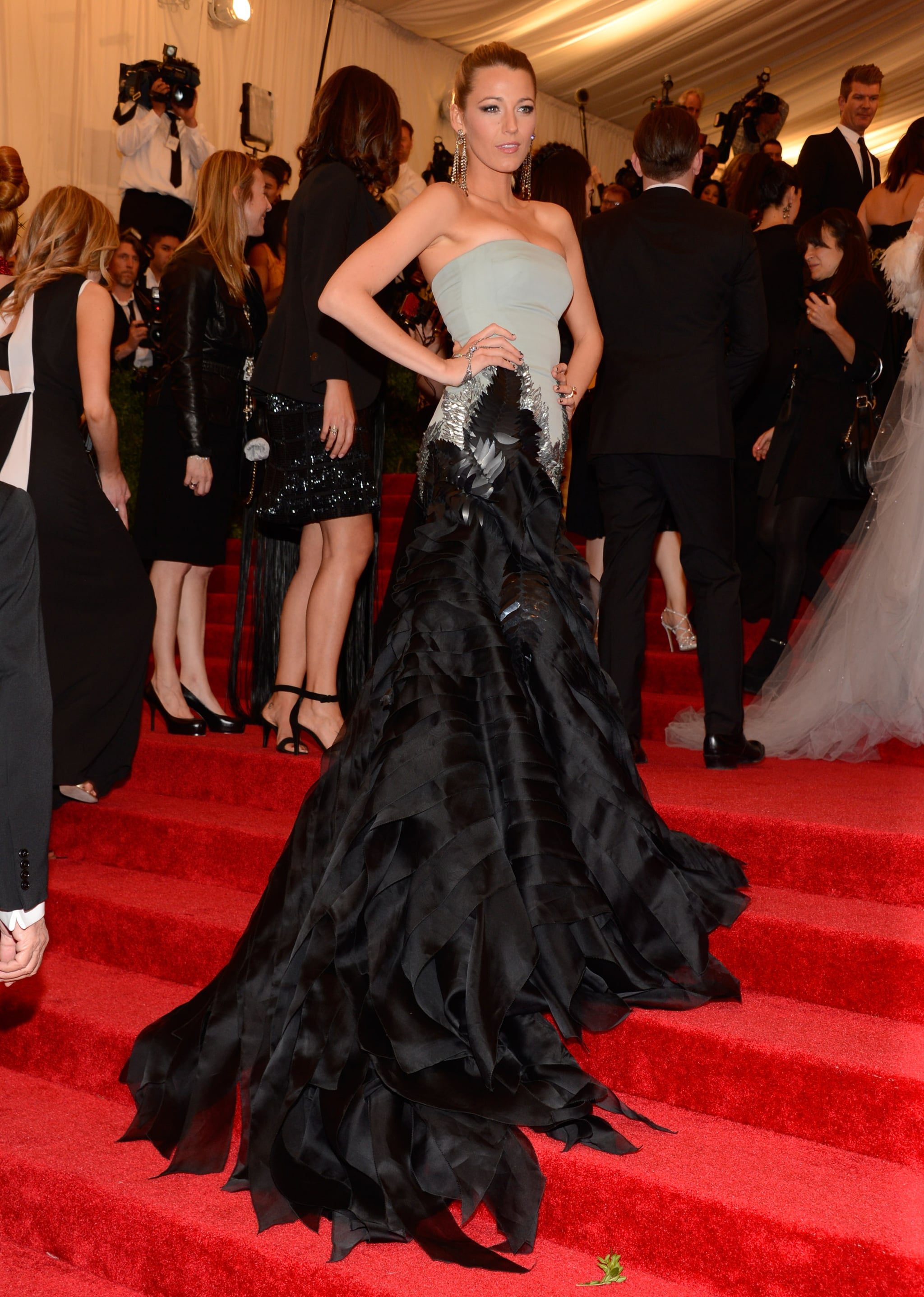 Blake Lively paused in the middle of the crowded staircase.