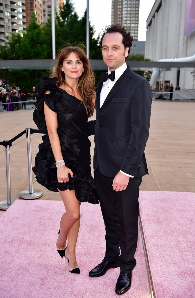 Even when they're not filming The Americans, Keri Russell and Matthew Rhys are picture perfect in every way. The couple, who are parents to son Sam (Keri is also mom to daughter Willa and son River from her previous marriage), had a sweet date night on Thursday when they attended the New York City Ballet's 2017 Fall Fashion Gala at Lincoln Center. While Matthew looked dapper in a black tux, Keri showed off some major leg in a sexy black dress. Aside from being supergiggly as they walked the pink carpet, the pair shared a sweet moment as Matthew playfully fixed Keri's hair in front of the cameras. These two always seem to have the best time together.      Related:                                                                                                           Keri Russell Really Can't Hide Her Smile Around Matthew Rhys