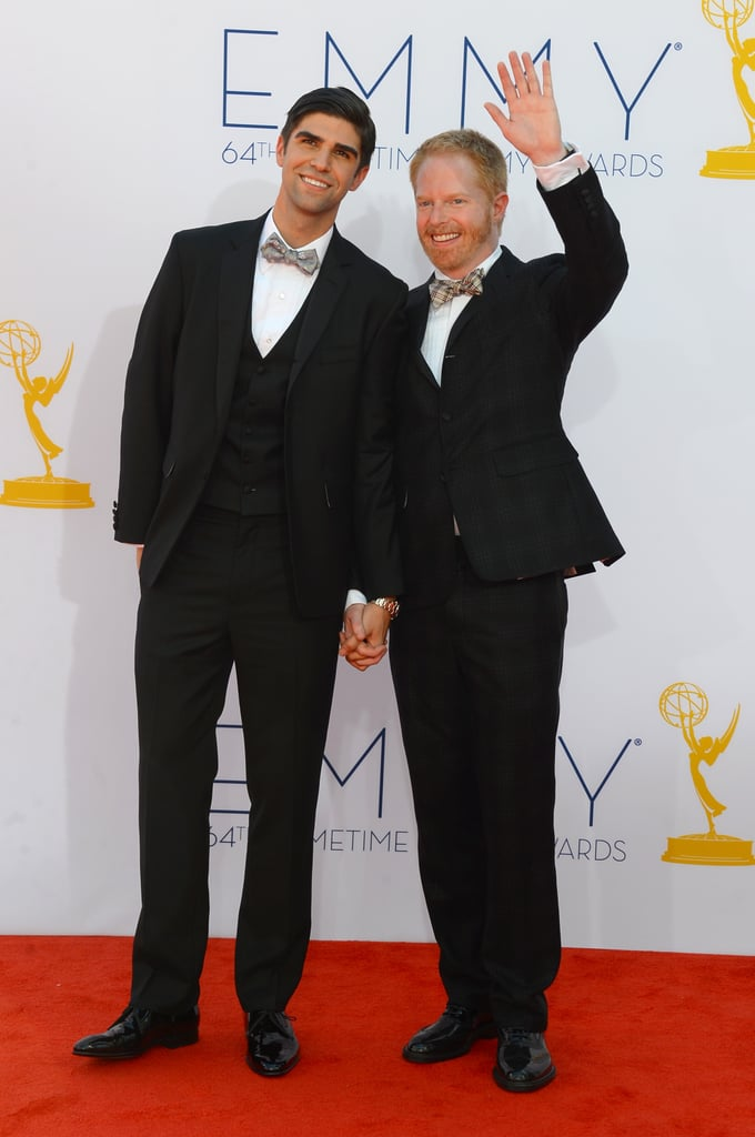 Justin Mikita and Jesse Tyler Ferguson were hand in hand on the red carpet.