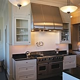 The kitchen's lighting fixtures offer a contemporary take on art-deco style.